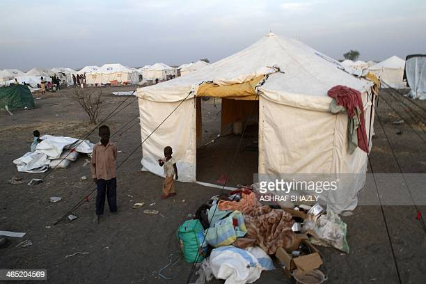 South Sudanese refugee children walk outside a makeshift tent at a camp run by Sudanese Red Crescent where they arrived with their families after...