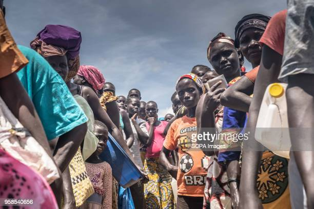 South Sudanese refugees line up for hours under the strong summer sun in order to collect their monthly food allowance by the World Food Program The...