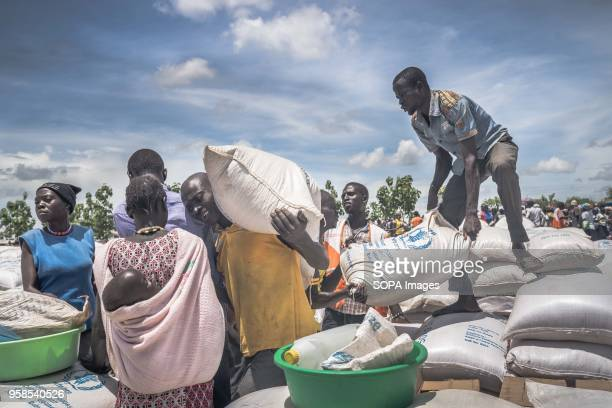 South Sudanese refugees seen collecting cassava flour provided by the World Food Program at the refugee settlement The Bidi Bidi refugee settlement...