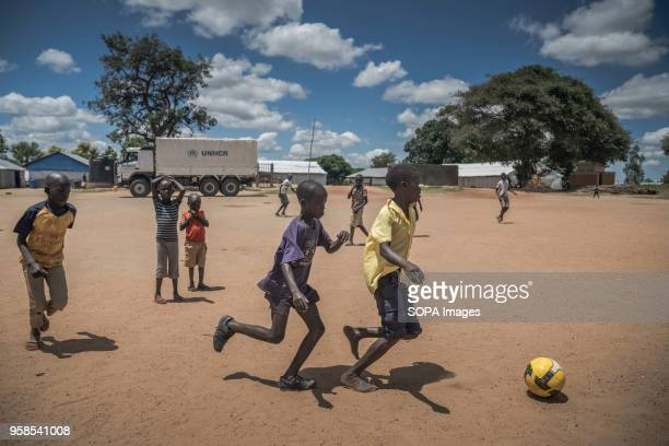 South Sudanese refugees seen enjoying a game of football in front of a UNHCR truck which has brought them here just few hours ago. The Kuluba refugee...