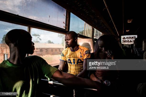 South Sudanese refugees sit in a bus transporting them from the border of South Sudan to a refugees settlement site in Democratic republic of the...