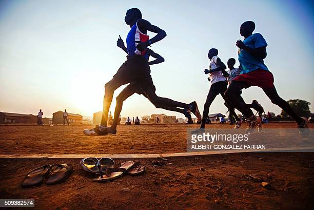TOPSHOT South Sudanese runners selected by the South Sudanese Athletic Federation train in the open field of the Buluk Athletics Track in Juba on...