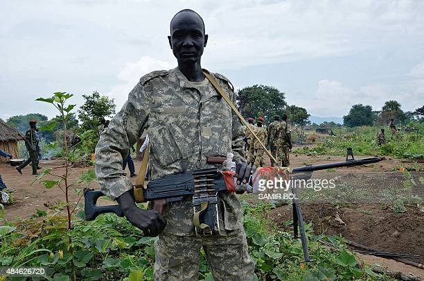 South Sudanese SPLA soldier is pictured in Pageri in Eastern Equatoria state on August 20, 2015. The spokesman of SPLA, Colonel Philip Aguer visited...