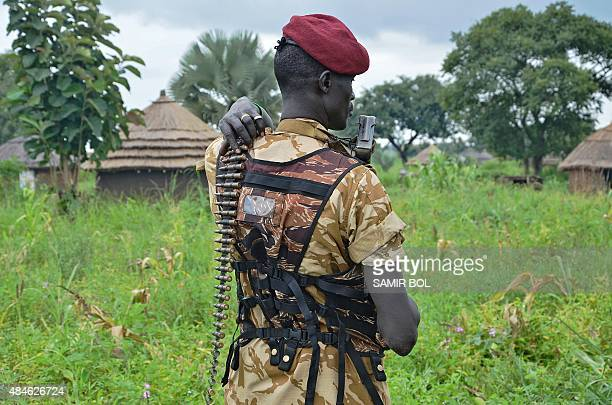 A South Sudanese SPLA soldier is pictured in Pageri in Eastern Equatoria state on August 20 2015 The spokesman of SPLA Colonel Philip Aguer visited...