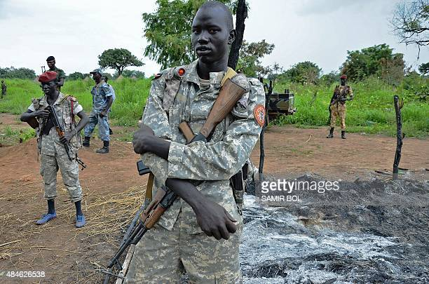 South Sudanese SPLA soldiers are pictured in Pageri in Eastern Equatoria state on August 20, 2015. The spokesman of SPLA, Colonel Philip Aguer...