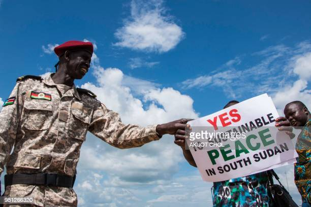 TOPSHOT South Sudanese wait for the arrival of South Sudan's President at Juba International Airport in Juba on June 22 2018 South Sudan's President...