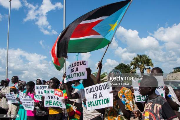 South Sudanese wait for the arrival of South Sudan's President Salva Kiir at Juba International Airport in Juba on June 22 2018 Kiir returns from...