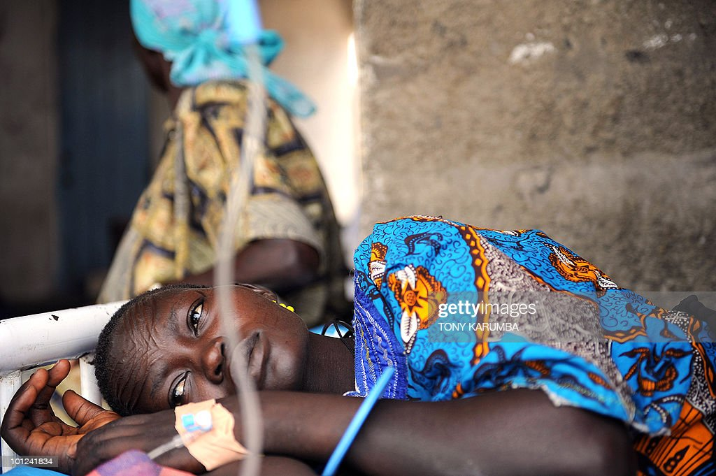 A south Sudanese woman lays in bed on April 2, 2009, at a health clinic in Terekeka, 82 km north of Juba, an area where the population is exposed to malaria, a vector-borne, infectious parasitic disease that is a leading cause of death of infants and children in Africa. Some 4-10 billion US dollars is still needed to ensure the achievement of the universal coverage of more than 6 million people by 2010 according to the Global Fund to Fight AIDS, Tuberculosis and Malaria who sponsor ongoing intervention programmes in south Sudan. UN Secretary General Ban Ki-moon said on March 31, in a video message played at the start of a two-day meeting in Spain of key donors to the Global Fund that malaria cost Africa 12 billion dollars a year, but just 3.4 billion dollars is needed annually for prevention and treatment. AFP PHOTO / Tony KARUMBA