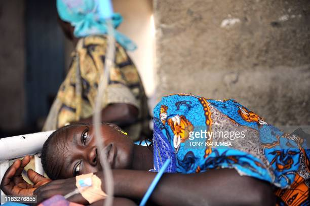 South Sudanese woman lays in bed on April 2 at a health clinic in Terekeka, 82 km north of Juba, an area where the population is exposed to malaria,...