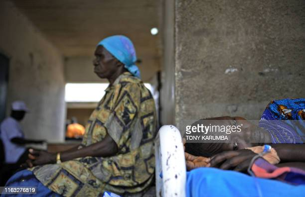 South Sudanese woman lays on a bed on April 2 at a health clinic in Terekeka, 51 miles north of Juba where the population is exposed to malaria, a...