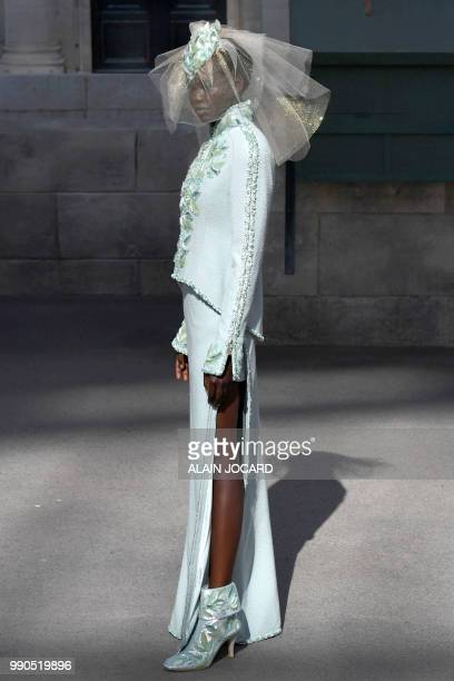 South SudaneseAustralian model Adut Akech presents a creation by Chanel during the 20182019 Fall/Winter Haute Couture collection fashion show at the...