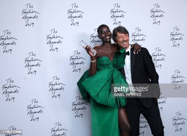 South SudaneseAustralian model Adut Akech winner of the Model of the Year award poses for a photograph with award presenter Pier Paolo Piccioli...
