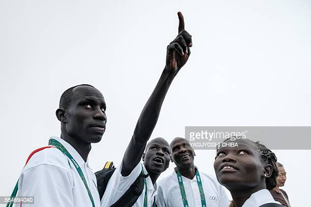 South Sudan's athlete James Nyang Chiengjiek , Yiech Pur Biel and Rose Nathike Lokonyen based in Kenya for the Refugee Olympic Team look up at the...