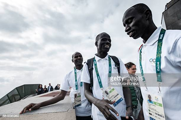 South Sudan's athlete Yiech Pur Biel and James Nyang Chiengjiek based in Kenya for the Refugee Olympic Team visit the statue of Christ the Redeemer...