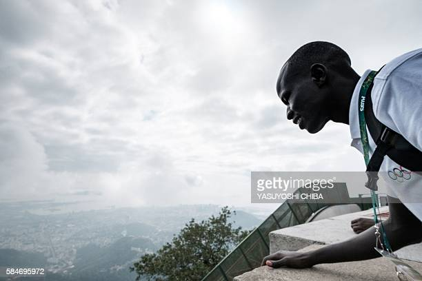South Sudan's athlete Yiech Pur Biel based in Kenya for the Refugee Olympic Team visits the statue of Christ the Redeemer ahead of Rio 2016 Olympic...
