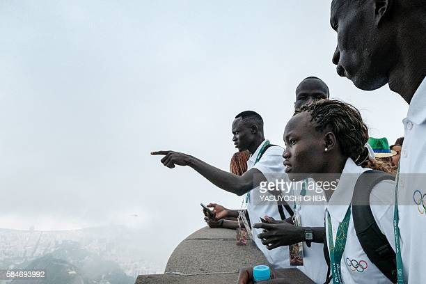 South Sudan's athletes for the Refugee Olympic Team look down Maracana Stadium in front of the statue of Christ the Redeemer ahead of Rio 2016...
