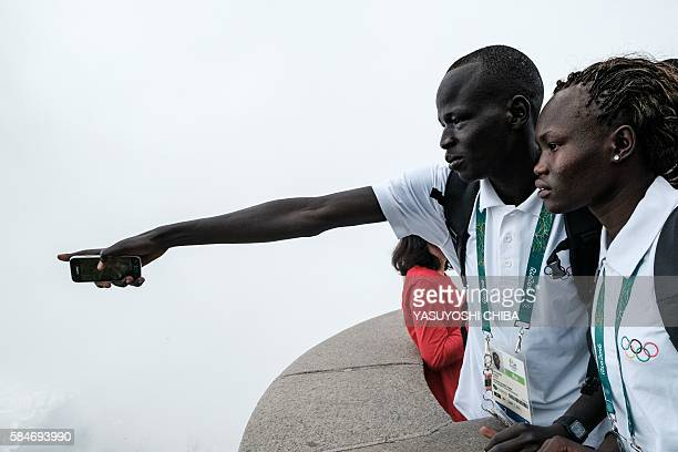 South Sudan's athletes Yiech Pur Biel and Rose Nathike Lokonyen based in Kenya for the Refugee Olympic Team look down Maracana Stadium in front of...