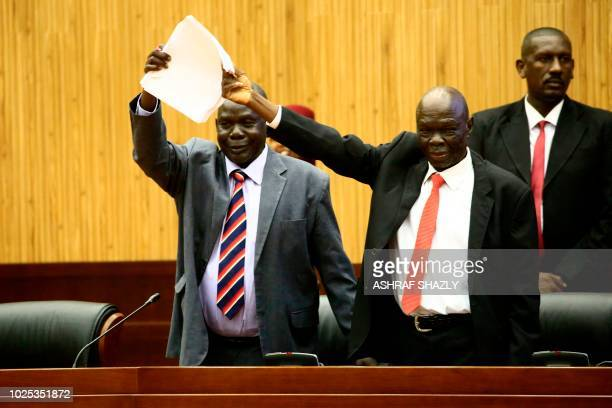 TOPSHOT South Sudan's delegates celebrate after signing a peace deal to end their civil war in Khartoum on August 30 2018 South Sudanese rebel chief...
