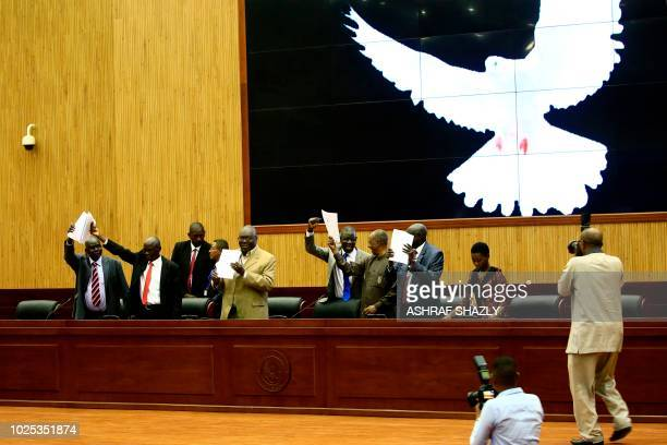 South Sudan's delegates celebrate after signing a peace deal to end their civil war in Khartoum on August 30 2018 South Sudanese rebel chief Riek...