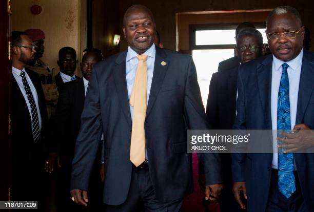 South Sudan's exiled rebel leader Riek Machar arrives for a meeting with his rival President Salva Kiir in Juba South Sudan on September 9 2019 South...