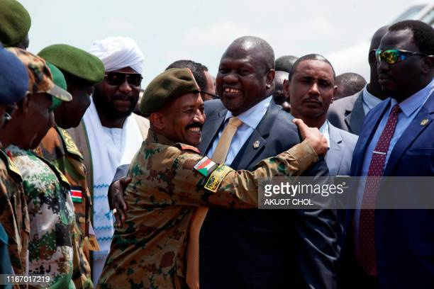 South Sudan's exiled rebel leader Riek Machar is welcomed by a Sudanese military officer in Juba South Sudan on September 9 2019 South Sudan's exiled...