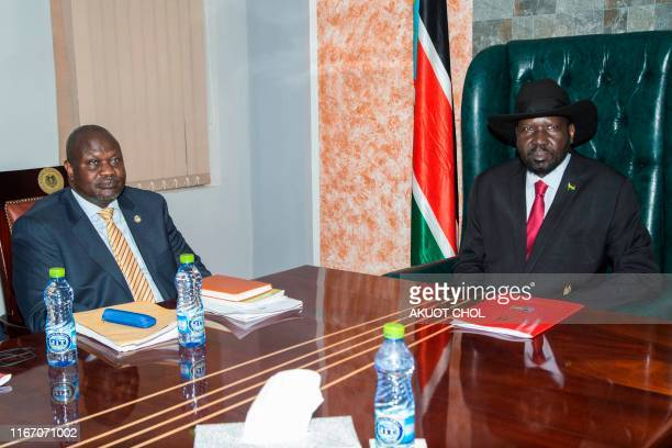 South Sudan's exiled rebel leader Riek Machar meets with president Salva Kiir at the presidential palace in Juba on September 9 2019 South Sudan's...