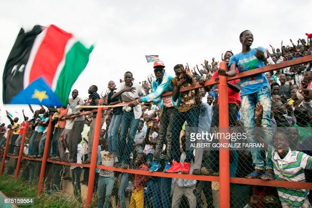 South Sudan's fans cheer after South Sudan scored a second goal during their first round African Nations Championship qualifying football match...