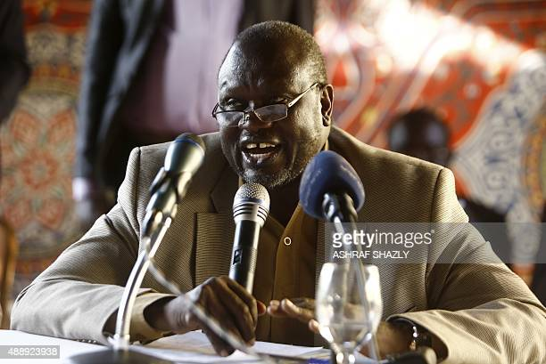 South Sudan's former Vice President and South Sudanese rebel leader Riek Machar speaks with displaced Sudanese people who fled South Sudan to...