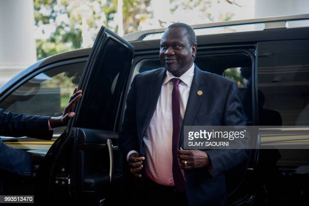 South Sudan's opposition leader Riek Machar arrives at Uganda's statehouse in Entebbe July 07 2018 where he along with South Sudan President are...