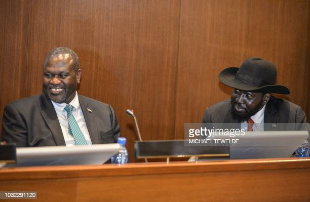 South Sudan's President Salva Kiir and his former deputy turned rebel leader Riek Machar react as they make a last peace deal at the 33rd...