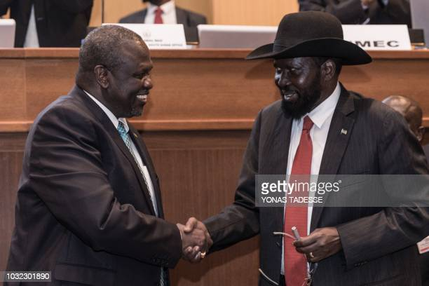South Sudan's President Salva Kiir and his former deputy turned rebel leader Riek Machar shake hands as they make a last peace deal at the 33rd...