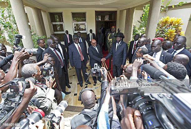 South Sudan's President Salva Kiir and Sudan's President Omar alBashir shake hands at the State house in Juba on April 12 2013 Bashir arrived in...