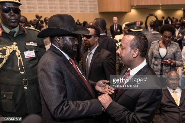 South Sudan's President Salva Kiir greets with Ethiopia's Ethiopia's Prime Minister Abiy Ahmed at the 33rd Extraordinary Summit of Intergovernmental...