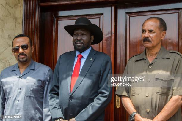 South Sudan's President Salva Kiir poses with Eritrea's President Isaias Afwerki and Ethiopia's Prime Minister Abiy Ahmed at the Presidential Palace...