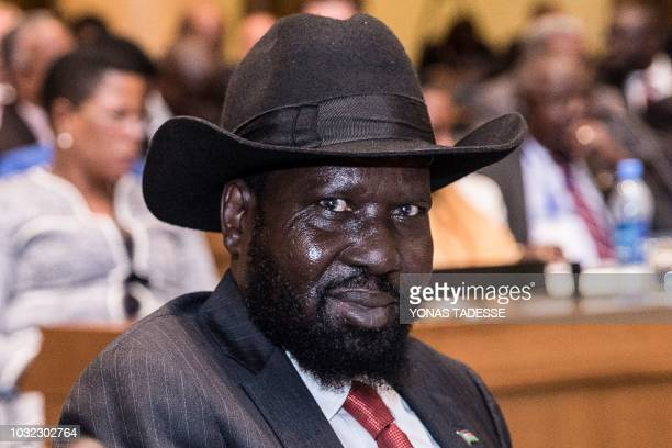 South Sudan's President Salva Kiir smiles as he takes part in a last peace deal with his former deputy turned rebel leader Riek Machar at the 33rd...