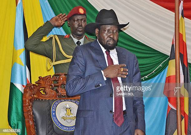 South Sudan's President Salva Kiir stands for South Sudan's national anthem before signing a peace agreement in the capital Juba, on August 26, 2015....