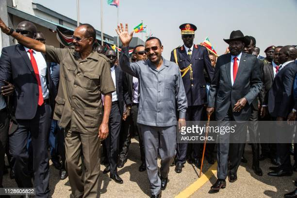 South Sudan's President Salva Kiir walks with Eritrea's President Isaias Afwerki and Ethiopia's Prime Minister Abiy Ahmed upon their arrival at Juba...