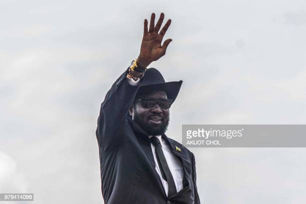 South Sudan's President Salva Kiir waves from the steps of an airplane at Juba Internaional Airport in Juba South Sudan on June 20 2018 before...