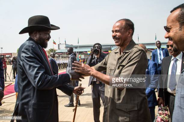 South Sudan's President Salva Kiir welcomes Eritrea's President Isaias Afwerki and Ethiopia's Prime Minister Abiy Ahmed upon their arrival at Juba...