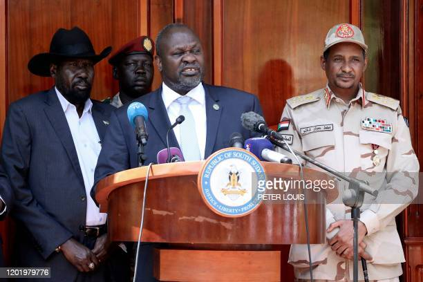 South Sudan's rebel leader Riek Machar addresses a press conference jointly with South Sudan President Salva Kiir after they met at the State House...