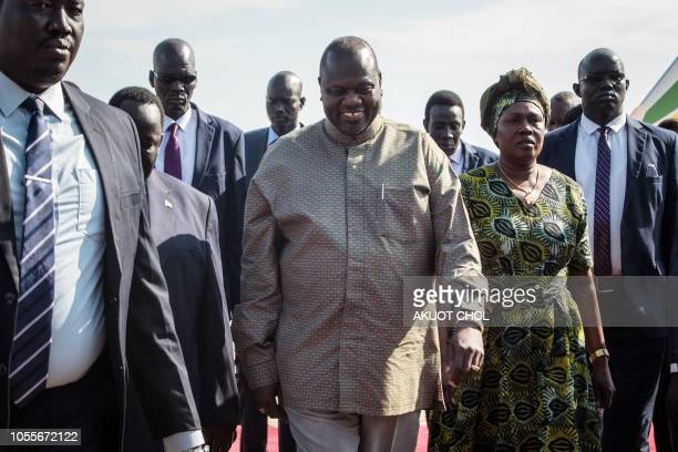 South Sudan's rebel leader Riek Machar arrives to Juba international airport with his wife to attend a peace ceremony in Juba South Sudan on October...