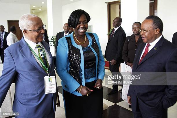 South Sudan's Water Minister Jemma Nunu Kumba shares a laugh with her Ethiopian counterpart Alemayehu Tegenu and her Tanzanian counterpart Jumanne...