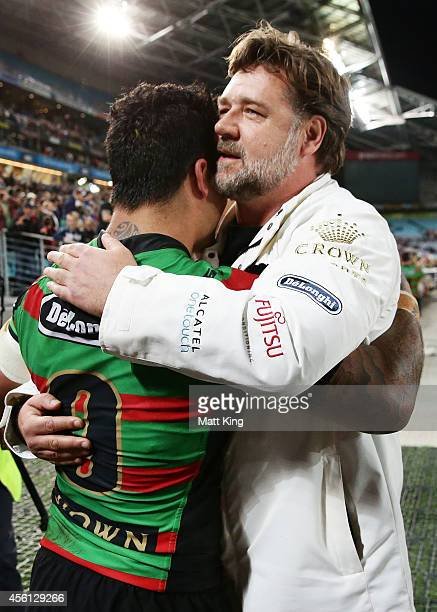 South Sydney Rabbitohs part owner Russell Crowe embraces Issac Luke of the Rabbitohs after the First Preliminary Final match between the South Sydney...