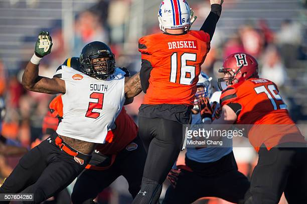 South team's defensive end Shawn Oakman with Baylor looks to block a pass by North team's quarterback Jeff Driskel with Louisiana Tech on January 30...