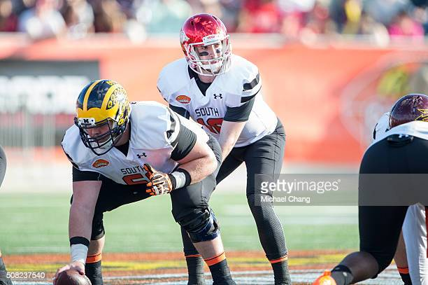 South team's quarterback Brandon Allen with Arkansas looks to receive the ball from South team's center Graham Glasgow with Michigan on January 30...