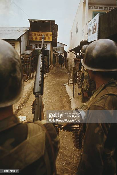 South Vietnamese ARVN Rangers on patrol advance cautiously down a narrow street during fighting in Saigon between South Vietnamese Rangers and North...