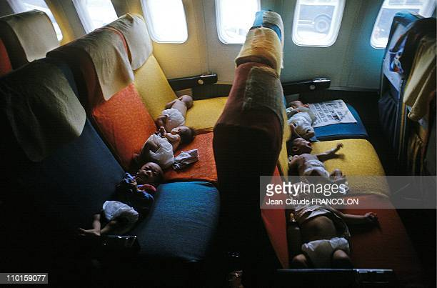 South Vietnamese babies on a flight from Saigon to the USA during Operation Babylift the mass evacuation of children from South Vietnam at the end of...