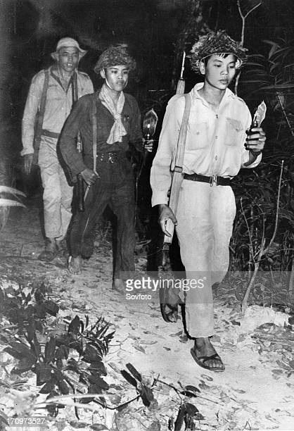 South vietnamese communist guerrillas on the ho chi minh trail at night vietnam war guerrillas carrying tiny lamps made from perfume bottles