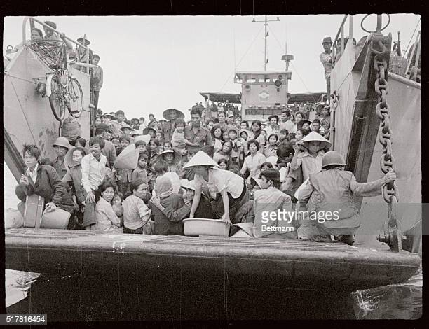 A South Vietnamese Navy landing craft fully loaded with refugees from hue 370 miles northeast of Saigon ferry additional numbers of people to Danang...