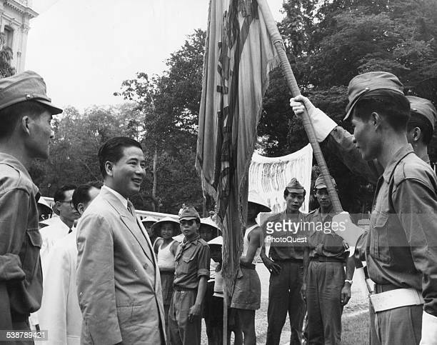 South Vietnamese President Ngo Dinh Diem Talks with standardbearing members of the Civil Guard during a ceremony marking a denunciation of Communism...